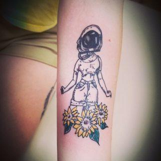 Tattoo girl helmet flowers